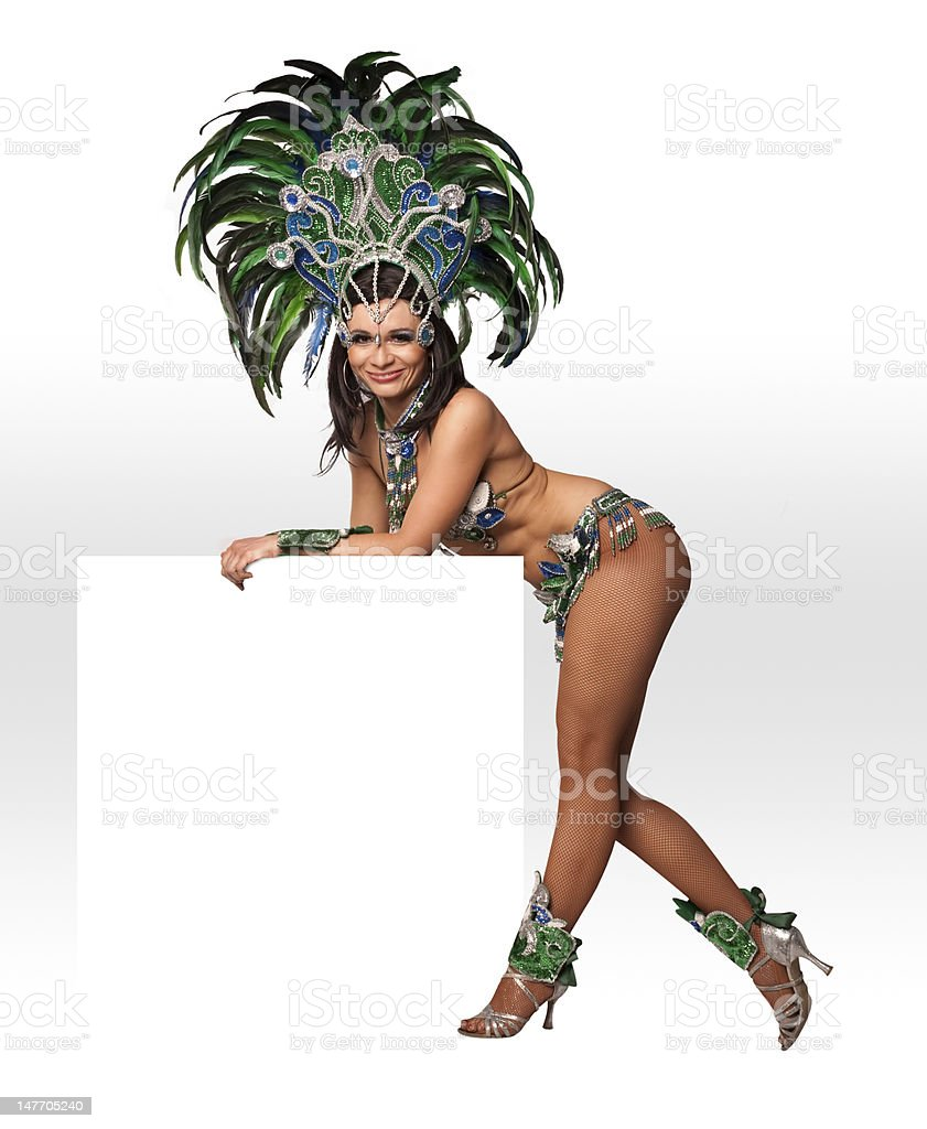 A half naked carnival dancer leaning on a block stock photo