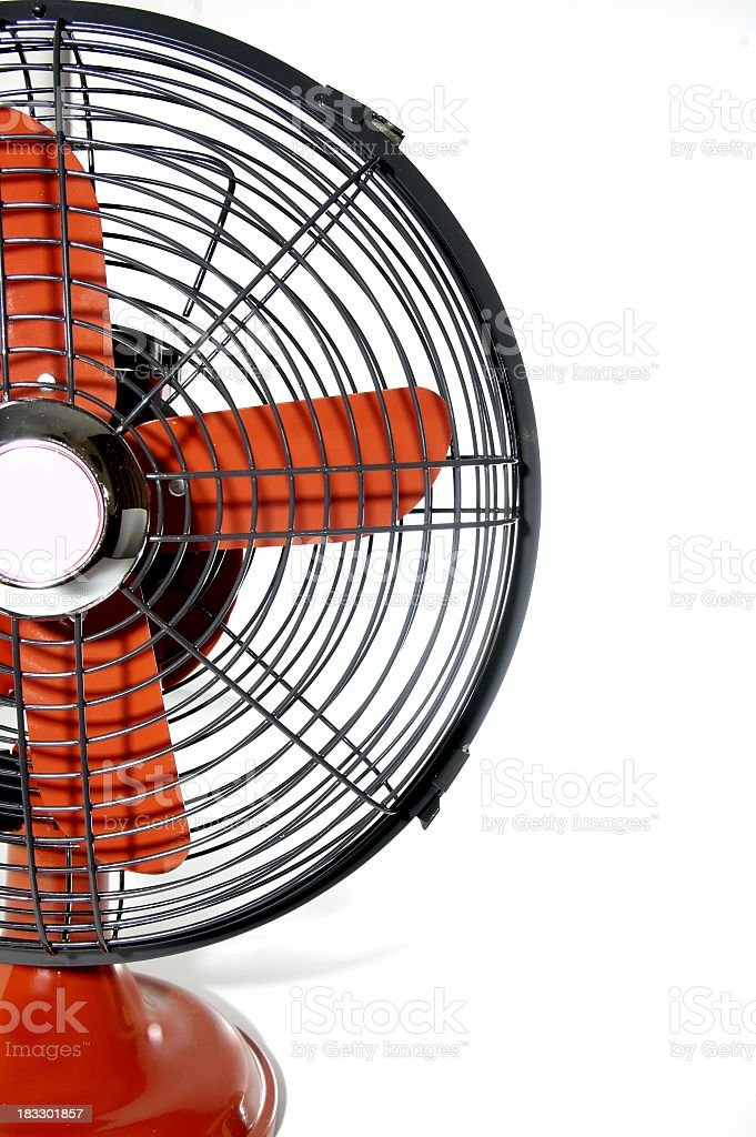 Half of a red electric upright fan royalty-free stock photo