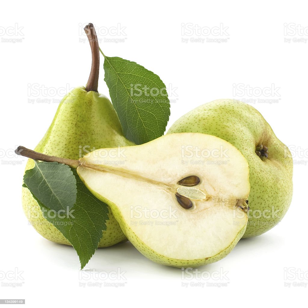 Half of a ripe pear and two whole pears on white background royalty-free stock photo