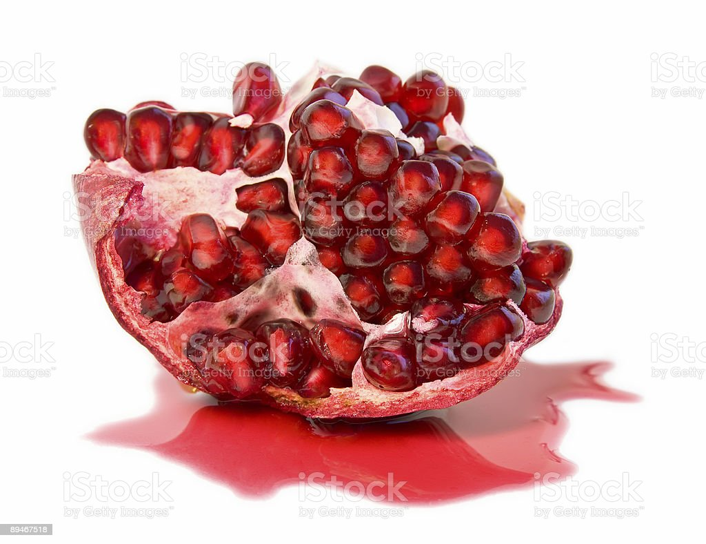 half of juicy ripe pomegranate (isolated, clipping path) stock photo
