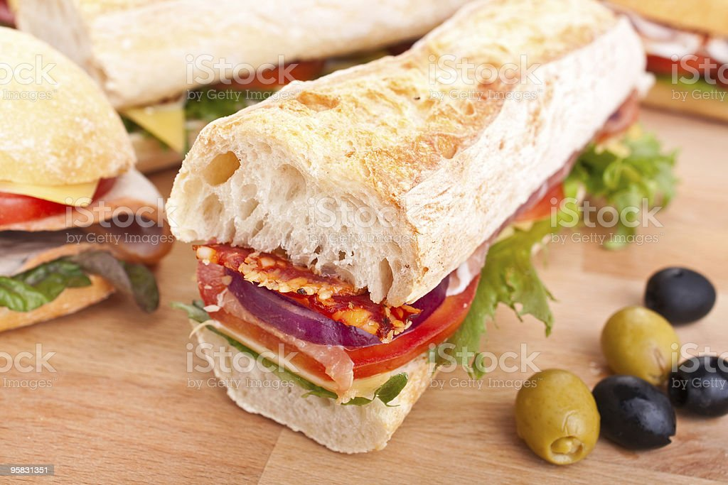 half of long white bread baguette sandwich royalty-free stock photo
