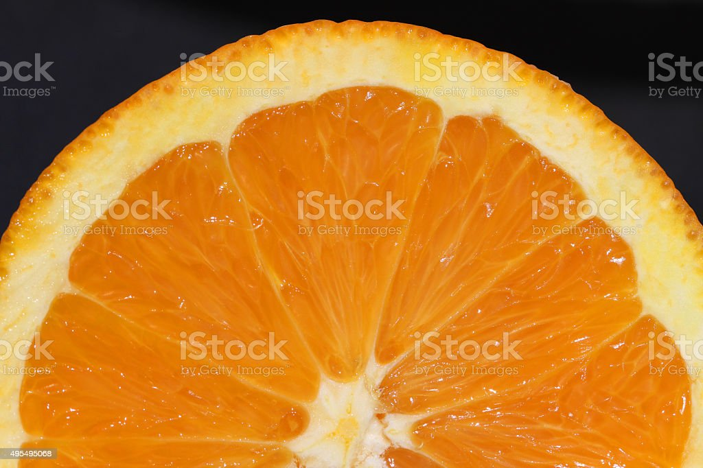 Half of orange on black background stock photo