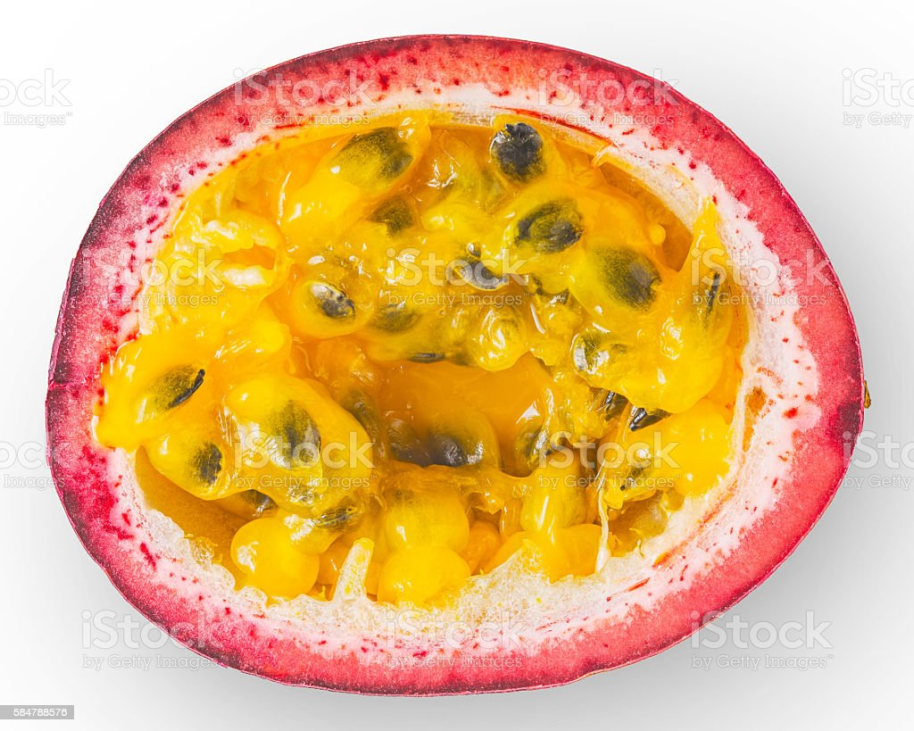 Half of passion fruit on the white background top view stock photo