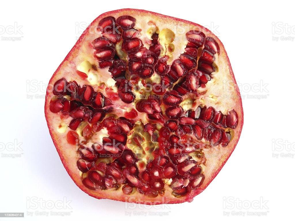 Half of pomegranate stock photo