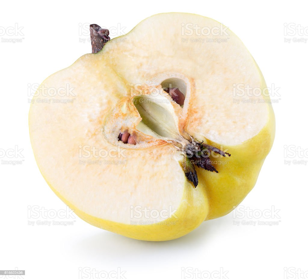 half of quince isolated on the white background stock photo