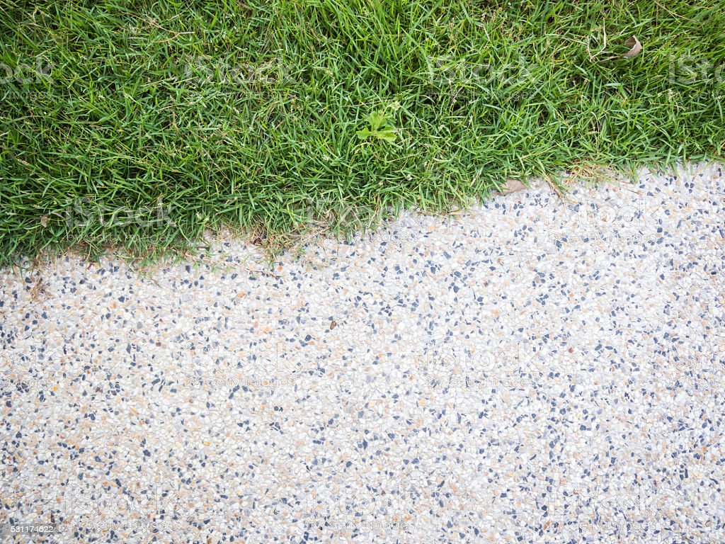 Half of stone walkway - small gravel floor and grass stock photo