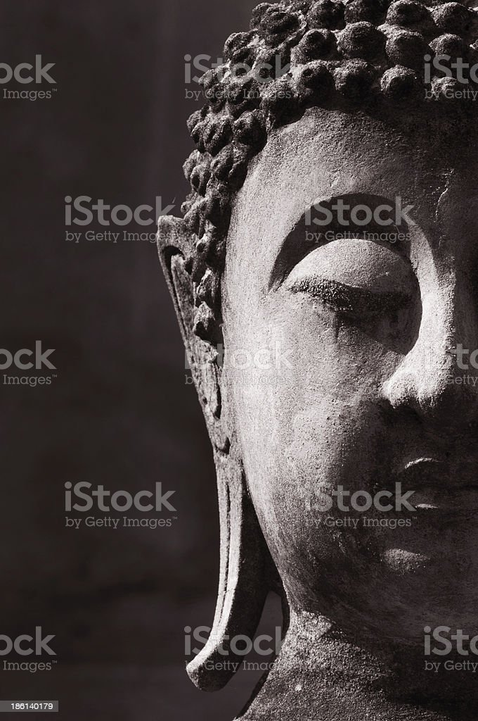Half of the face of a Buddha statue royalty-free stock photo