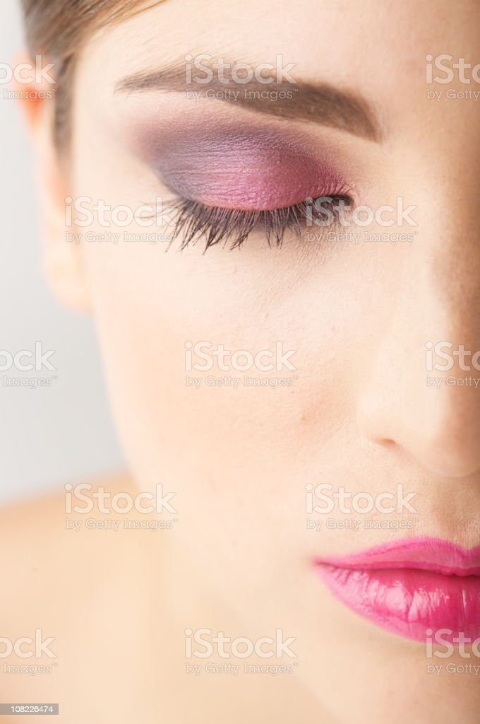 Half of Woman's Face with Closed Eye Wearing Make-up stock photo