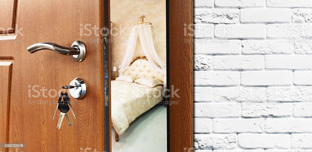 Half open door of a classic bedroom closeup stock photo