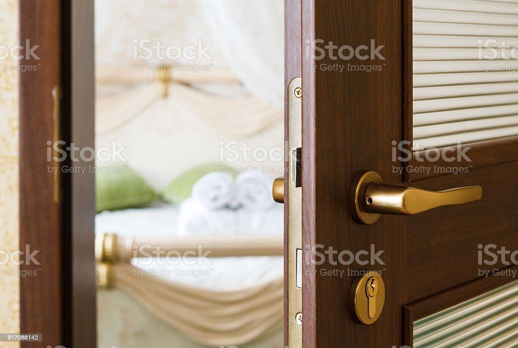 Half open door of a hotel bedroom stock photo