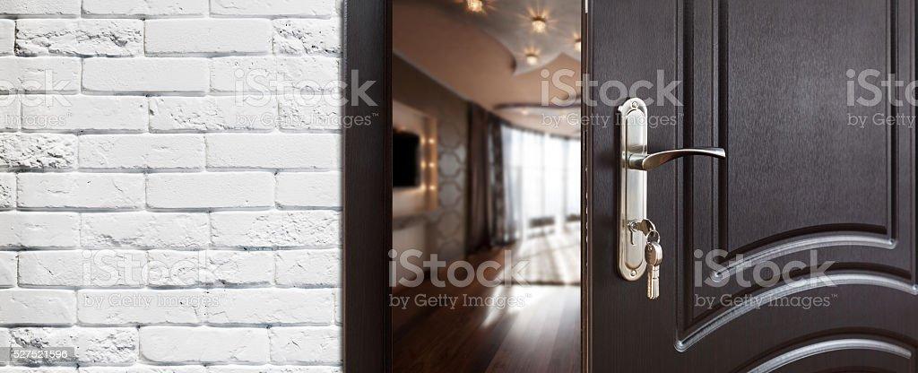 Half open door of a modern living room closeup stock photo