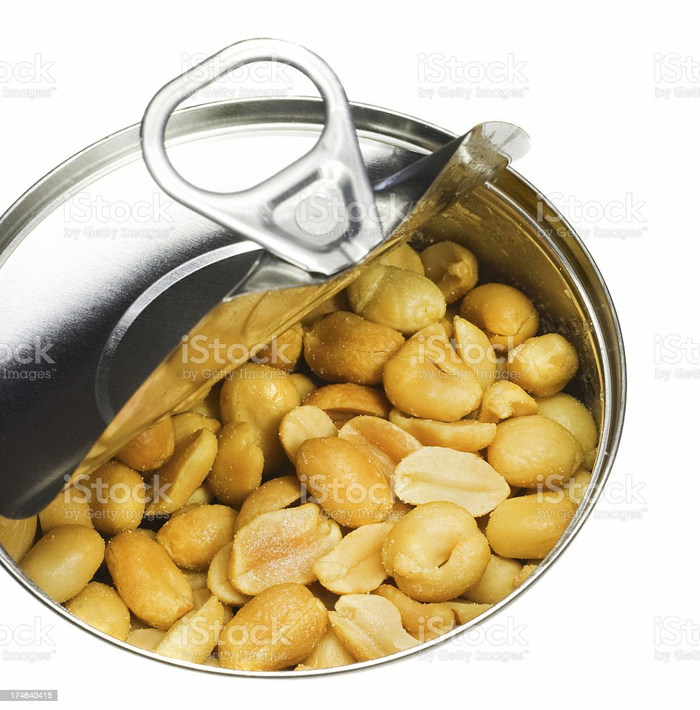 Half opened can of roasted peanuts stock photo