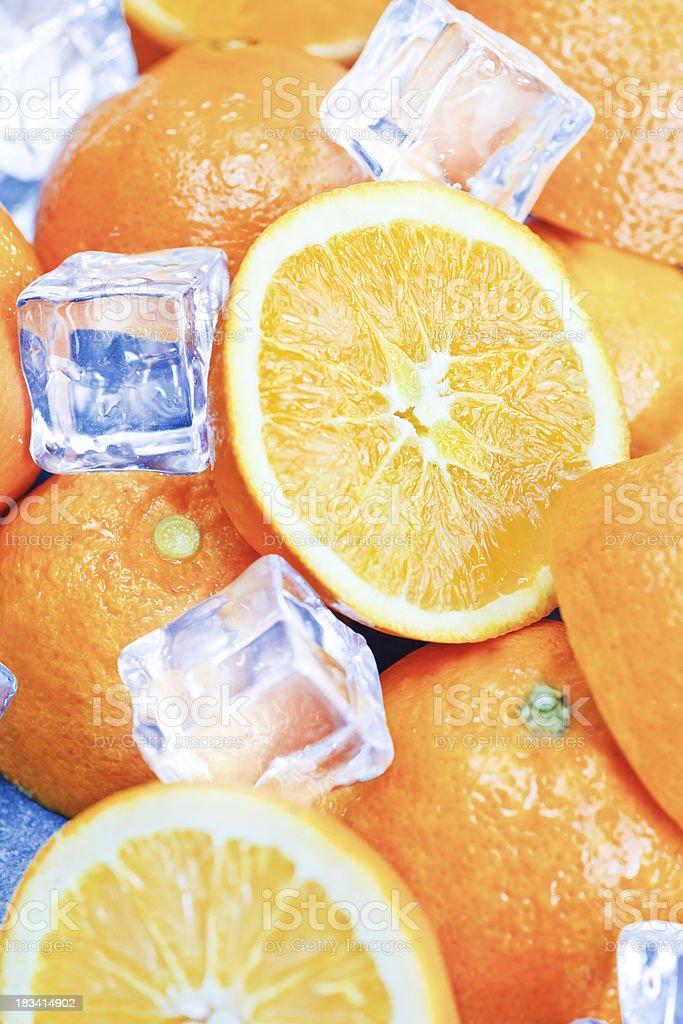 Half oranges granite table with icecubes royalty-free stock photo
