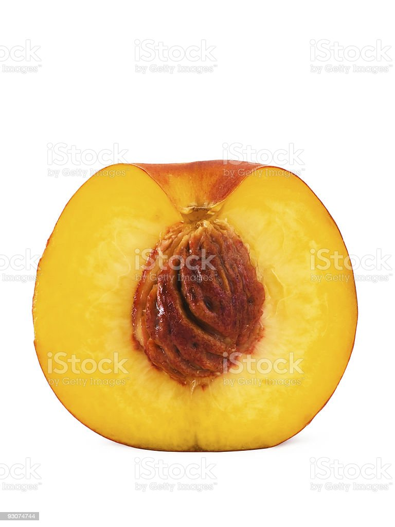 Half peach isolated on white, close-up royalty-free stock photo