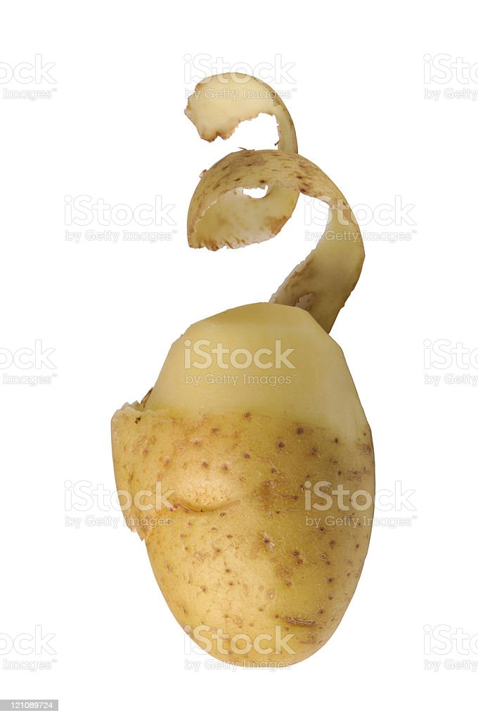 A half peeled potato on a white background  stock photo
