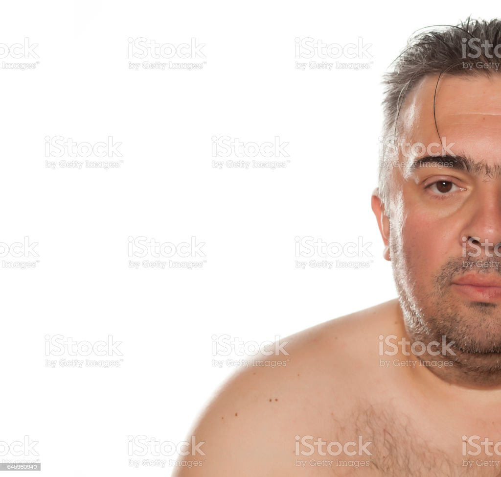 Half portrait of a serious obese man stock photo