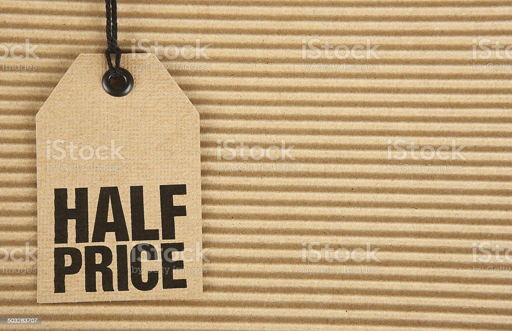 Half Price on Cardboard Tag on Corrugated Cardboard stock photo