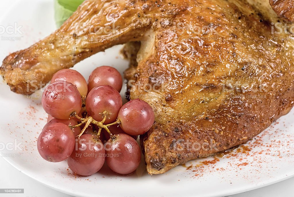 Half roasted chicken closeup stock photo