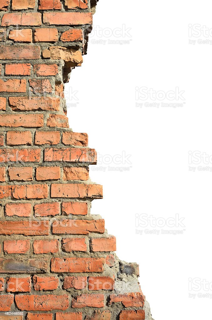 Half ruined brick wall on a white background stock photo