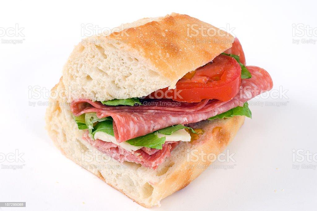 Half Salami and swiss cheese sandwich royalty-free stock photo