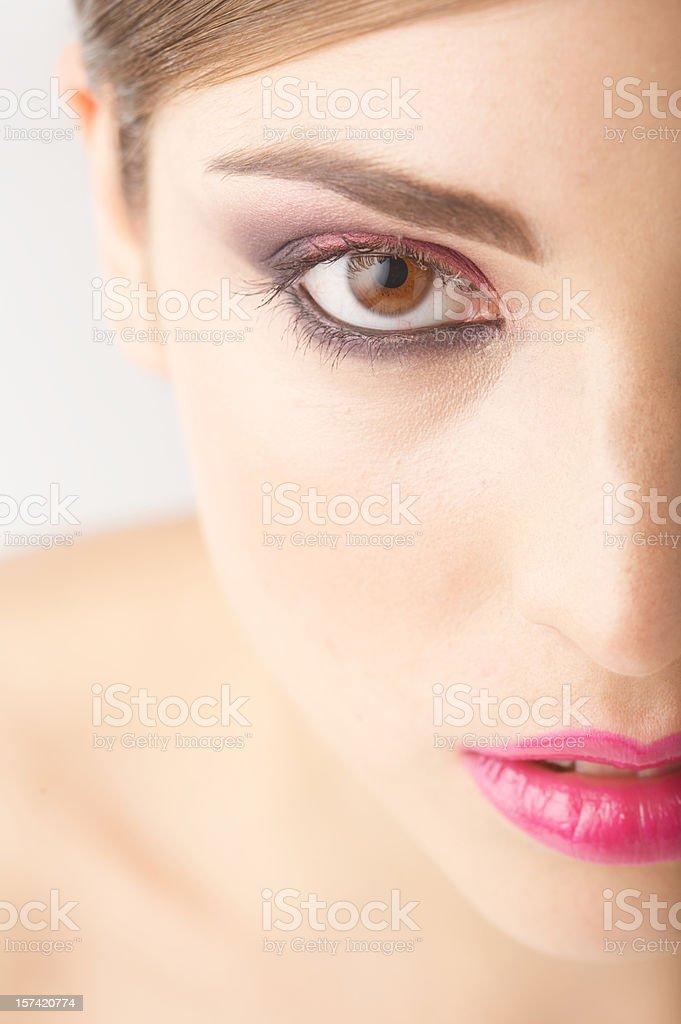Half side of beautiful woman face looking at camera stock photo