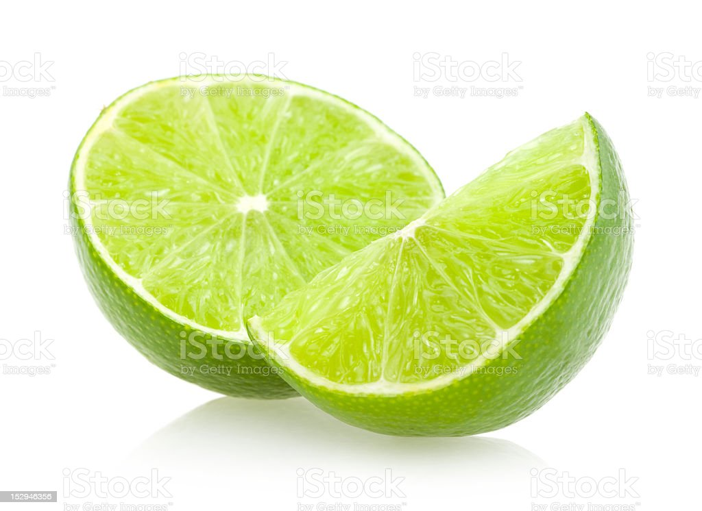 Half slice of lime and a wedge of lime stock photo