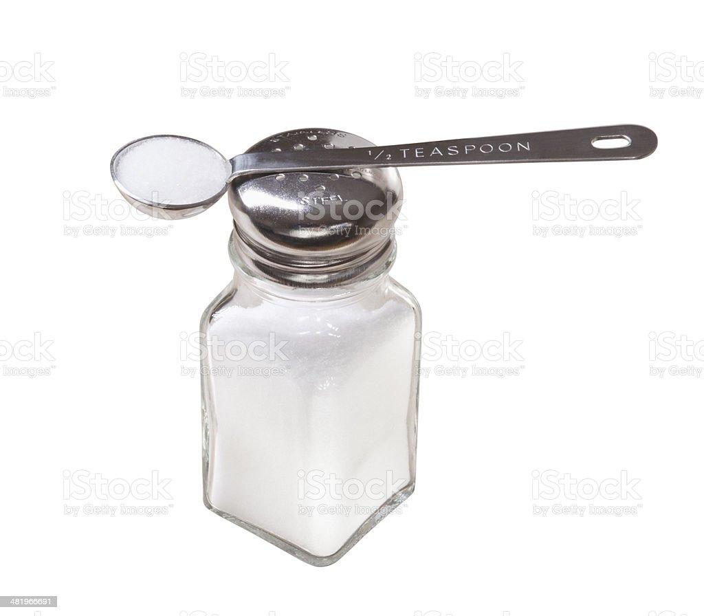 Half Teaspoon of Table Salt in Measuring Spoon on Shaker royalty-free stock photo