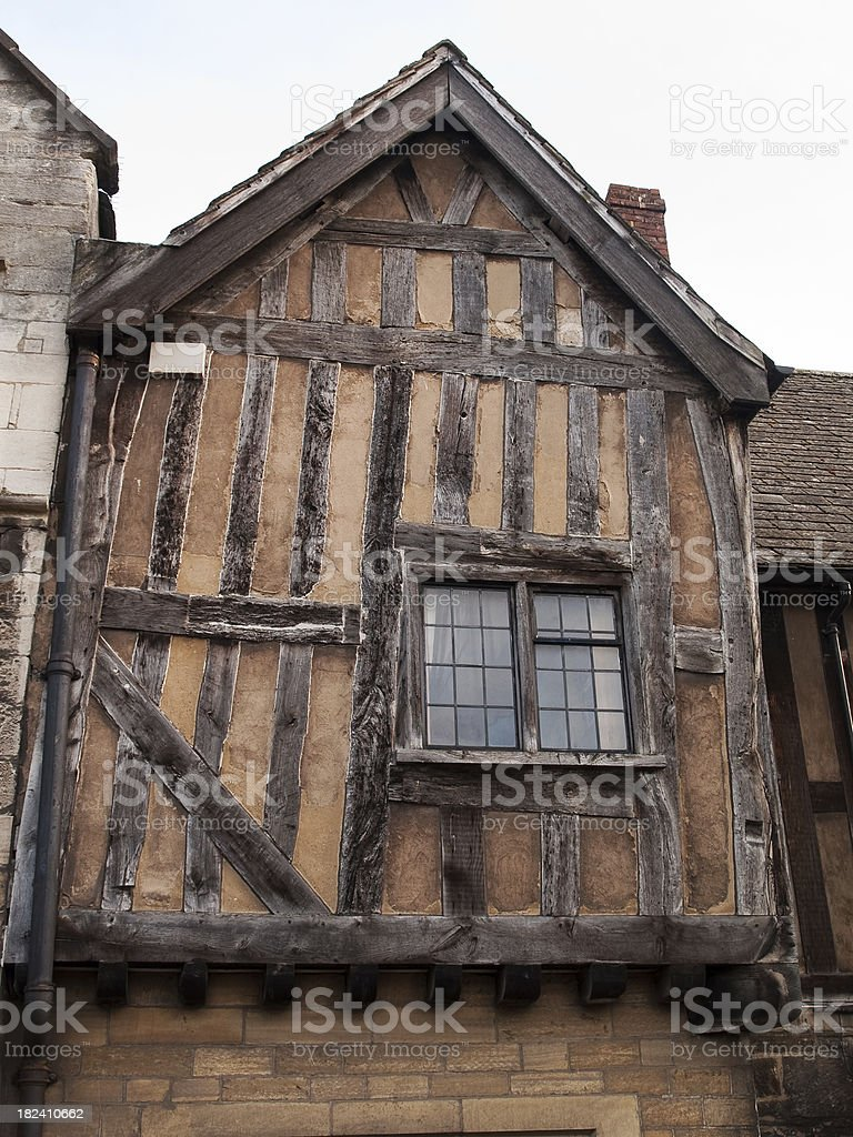 Half timbered building unpainted Gloucester royalty-free stock photo