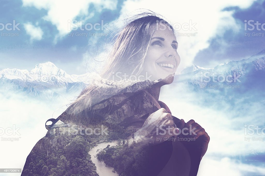 half transparent woman's portrait overlaying the mountain landscape stock photo