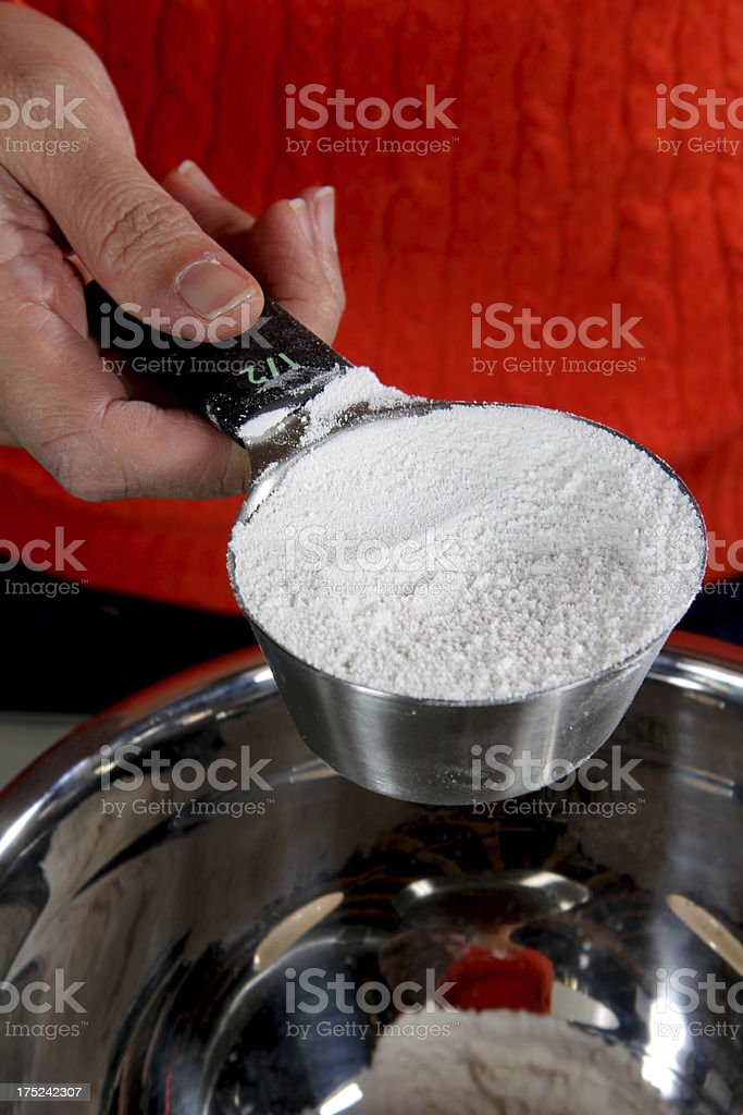 Half-Cup Measuring Cup of Flour royalty-free stock photo