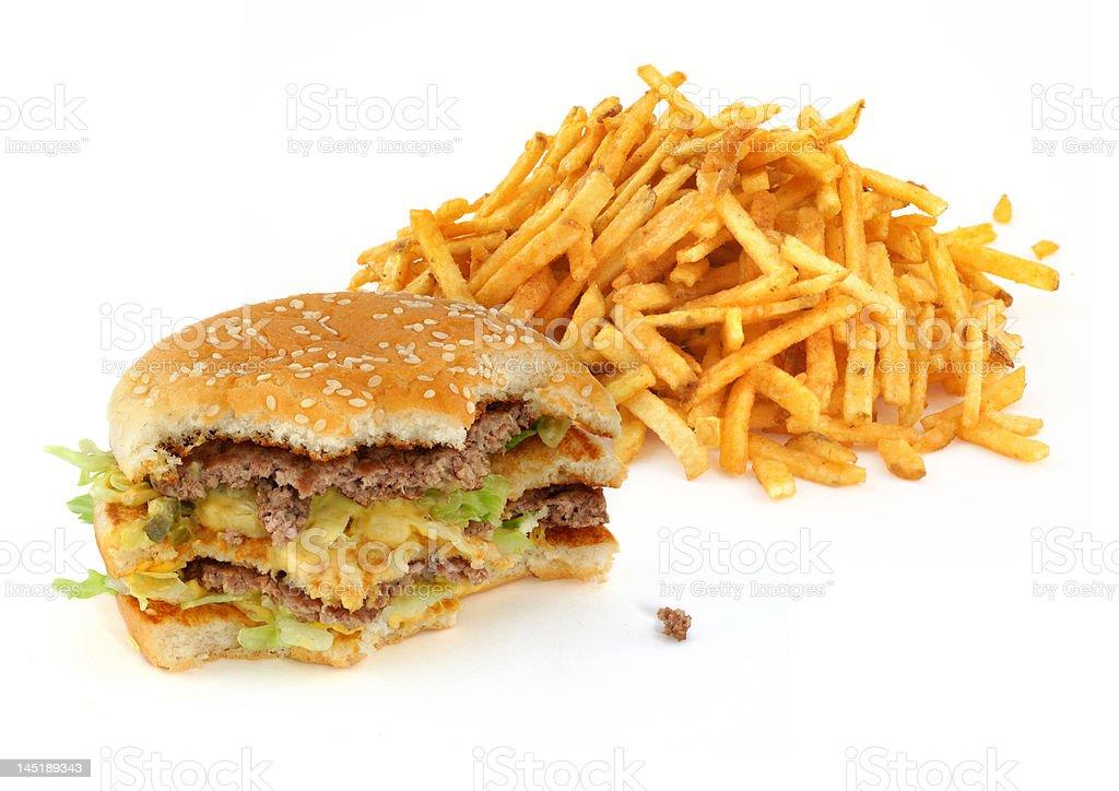 half-eaten hamburger and french fries royalty-free stock photo