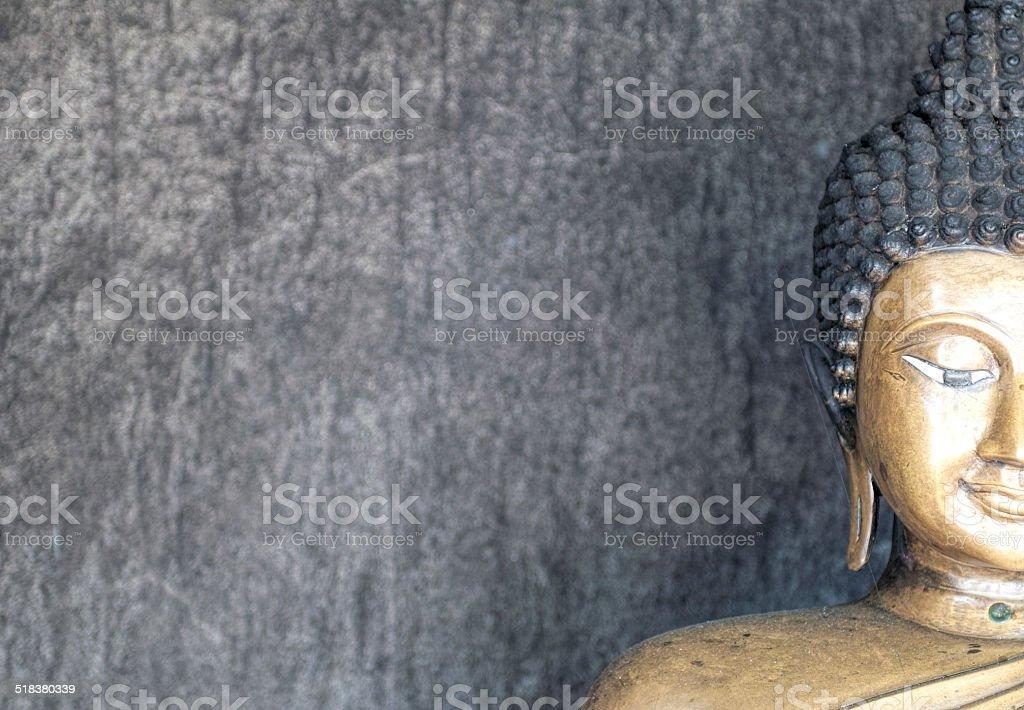 half-face buddhaimage stock photo