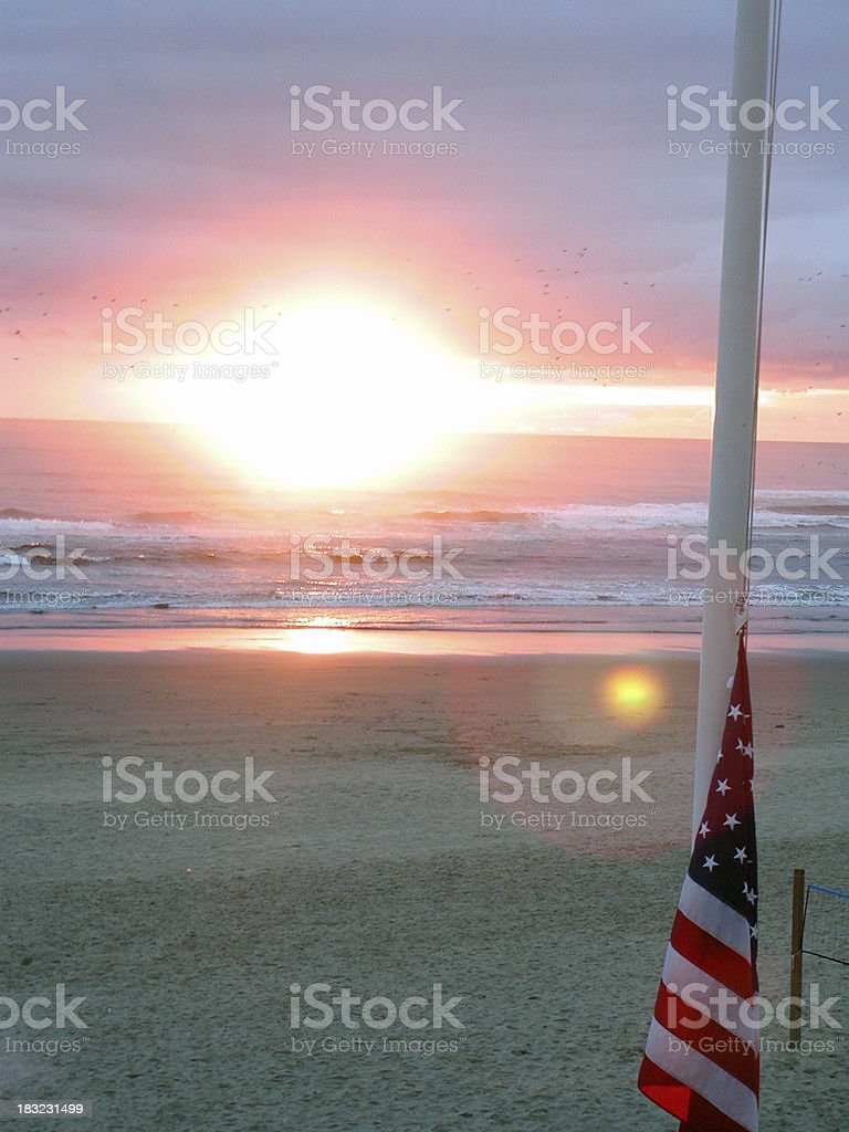 Half-mast flag at sunset royalty-free stock photo