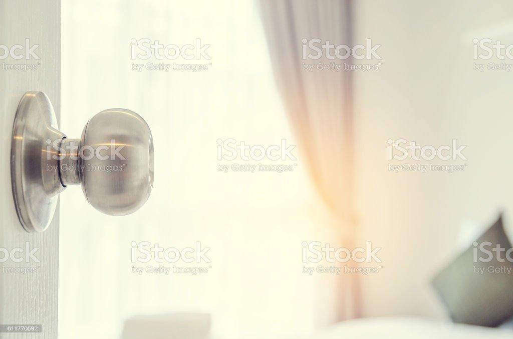 half-open door of a bedroom stock photo