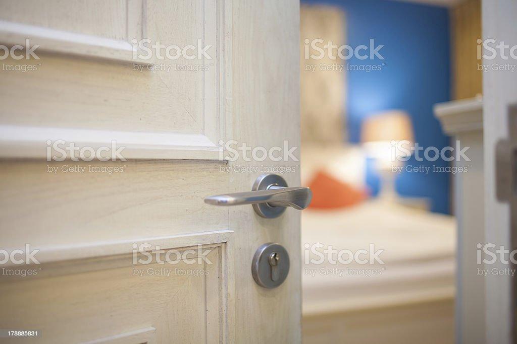 half-open unlock door of a bedroom stock photo