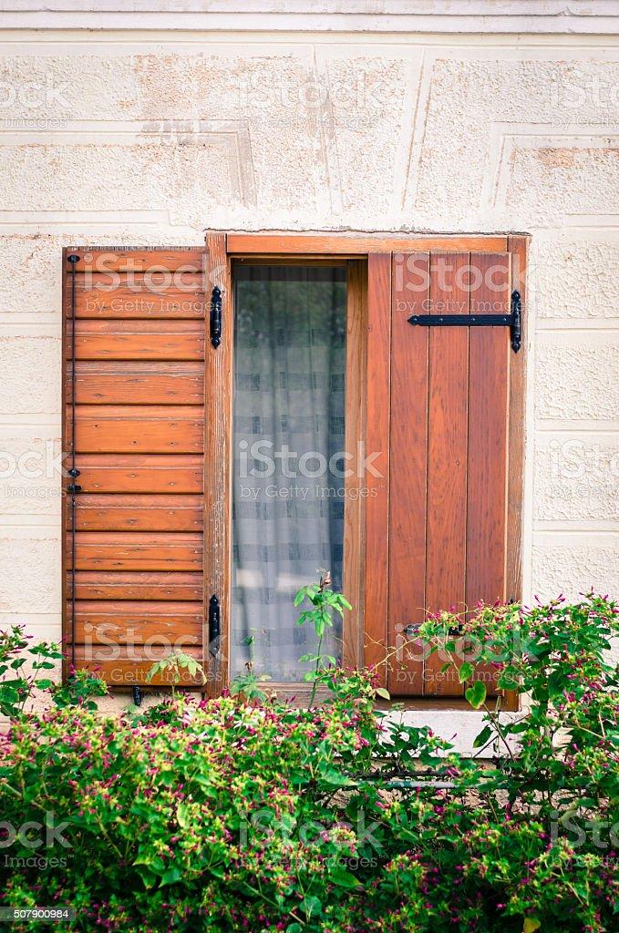 half-open wooden window stock photo