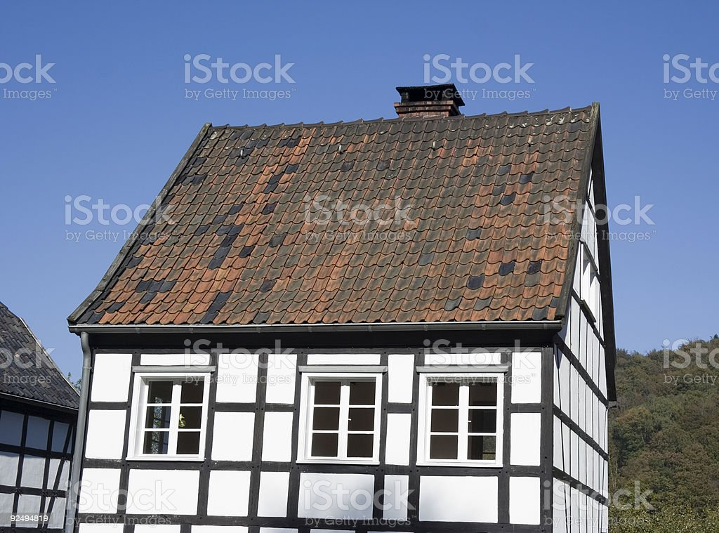 half-timbered house in black and white stock photo