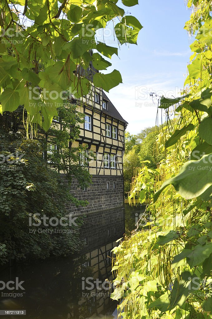 Half-timbered house in green environment, Germany royalty-free stock photo