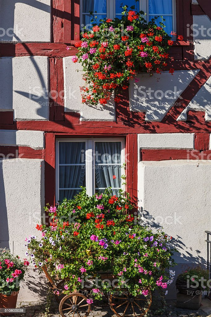Half-timbered House with flowers stock photo