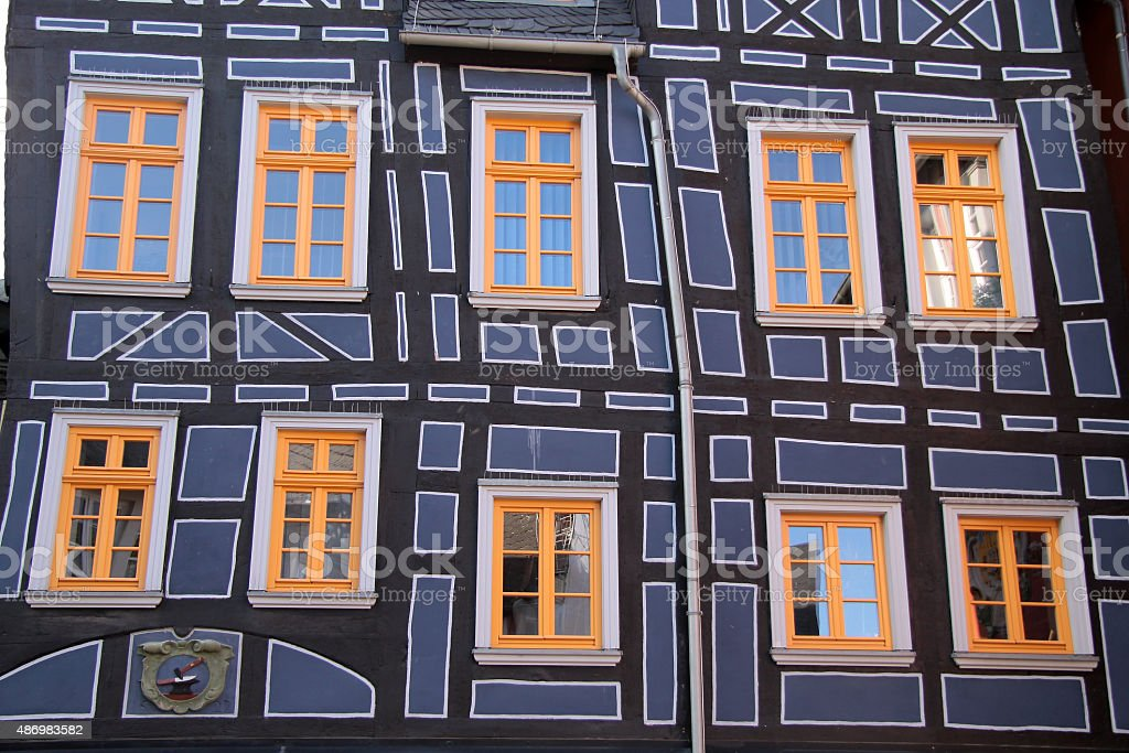 half-timbered house with yellow windows stock photo