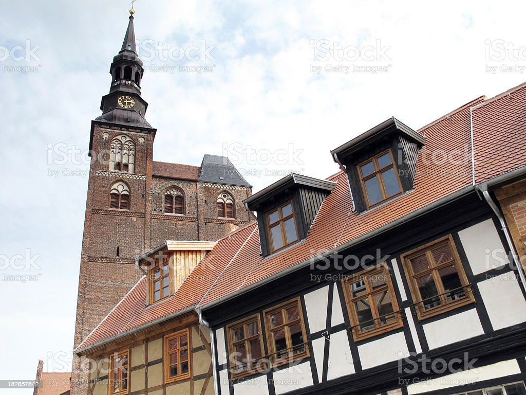 half-timbered houses and cathedral of Tangermünde at Elbe River (Germany) stock photo