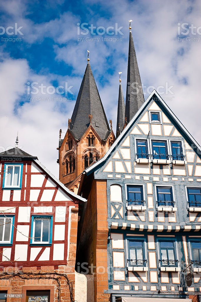 Half-timbered Manors in Front of a Church stock photo