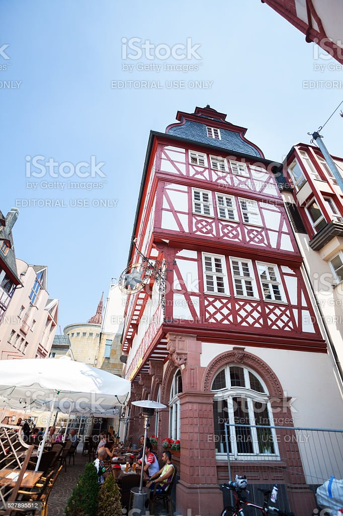 Half-timbered old building with bar in Bendergasse - Römerberg stock photo
