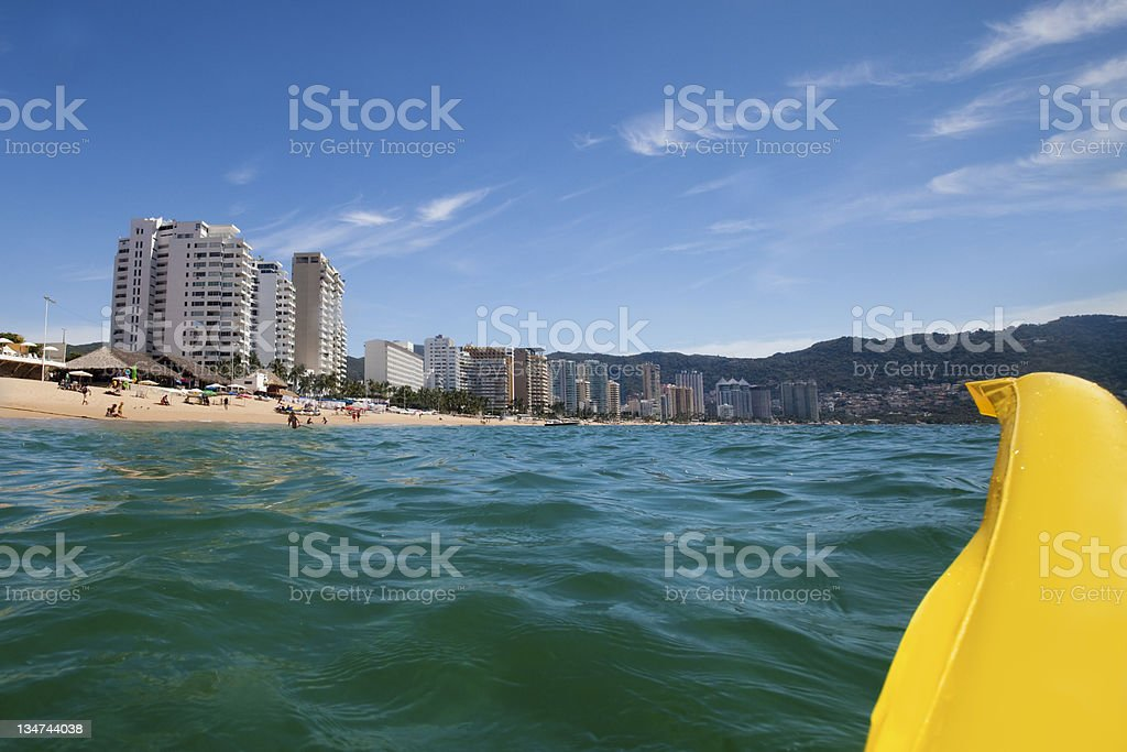 A half-view of floating yellow raft on the sea royalty-free stock photo