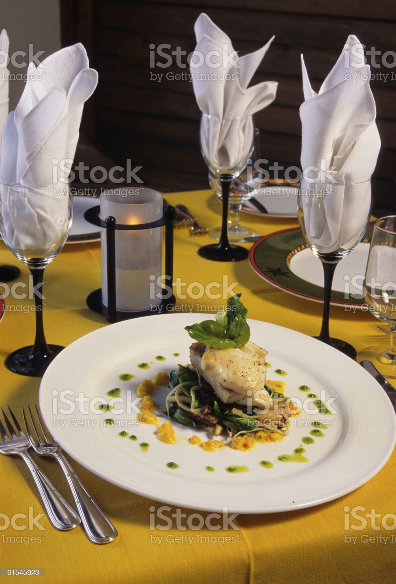 Halibut Fish Entree Plated Fine Dining Dinner Setup in Restaurant royalty-free stock photo