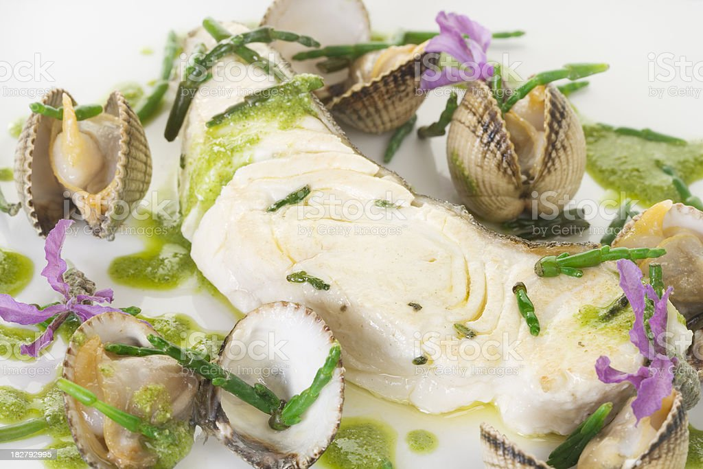 halibut steak with samphire and cockes stock photo