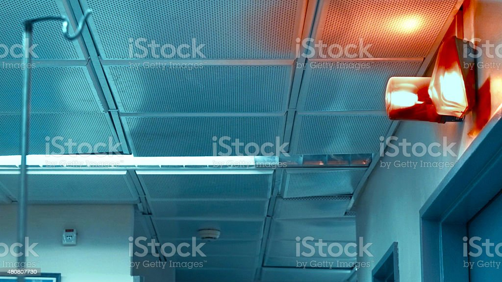 Hall in the hospital with red siren on wall stock photo