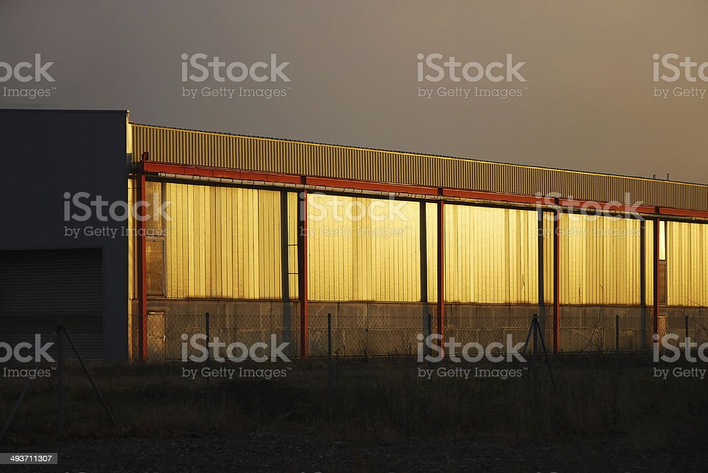 Hall of a factory with golden gates stock photo