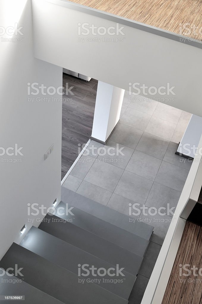 Hall, staircase in modern apartment interior, wooden floors, concrete stairs stock photo