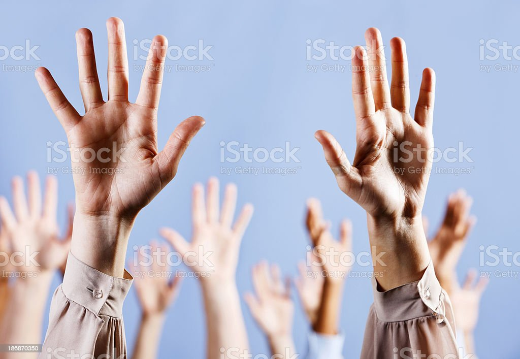 Hallelujah! Hands raised enthusiastically against blue background stock photo